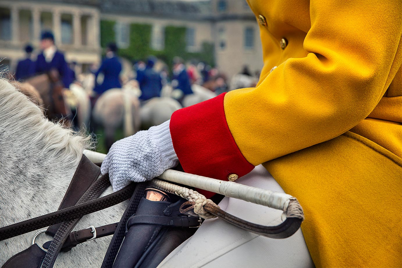 Charlton Hunt Huntsman mounted in front of Goodwood House