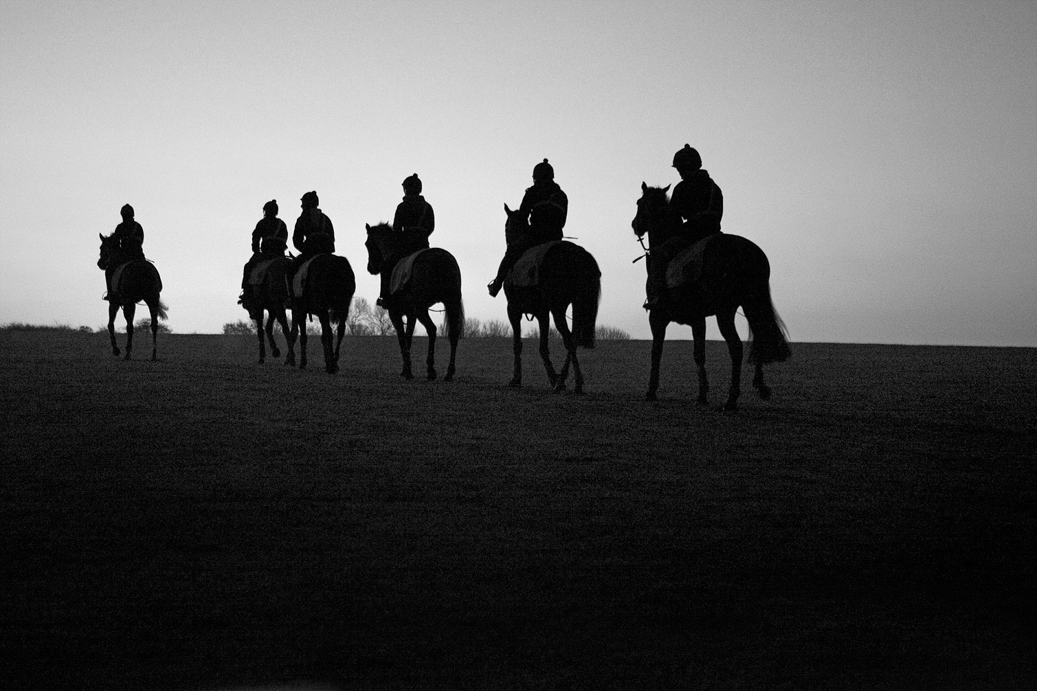 Riders-and-horse-against-the-dawn-sky-B_W